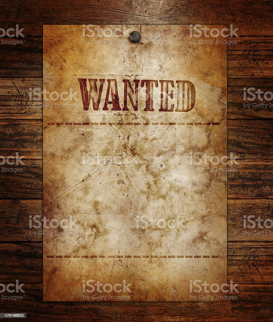 Vintage wanted poster on a wooden wall royalty-free stock photo