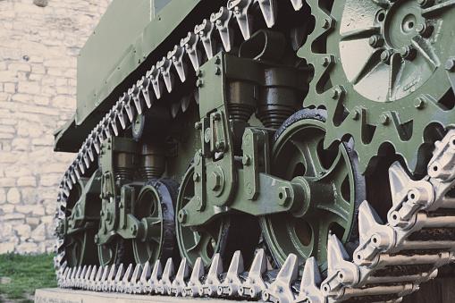 Restored vintage war tank wheels close up with link