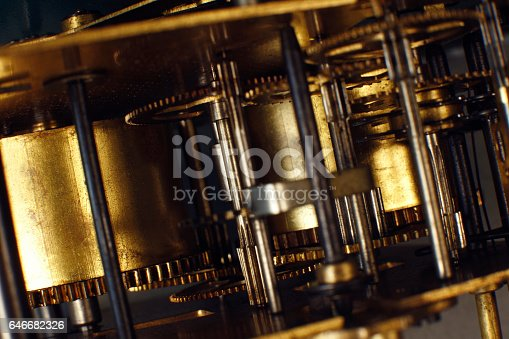 istock Vintage watch machinery macro detail. Clockwork of old clock close up. 646682326