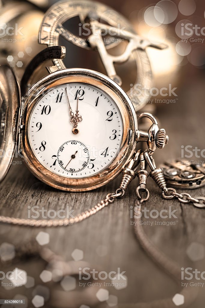 Vintage watch on abstract vintage background showing five to twe stock photo