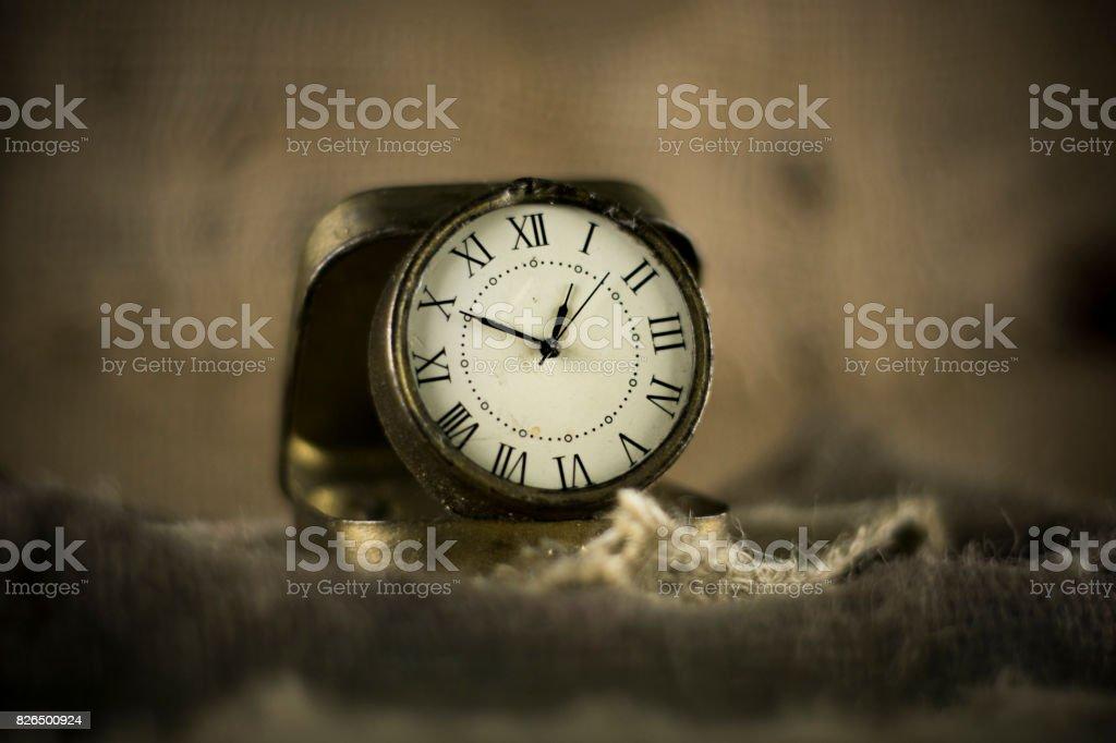 vintage watch on burlap dark stock photo