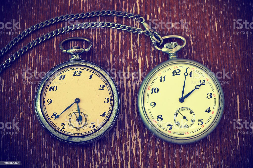 Vintage watch with chain on vintage background royalty-free stock photo