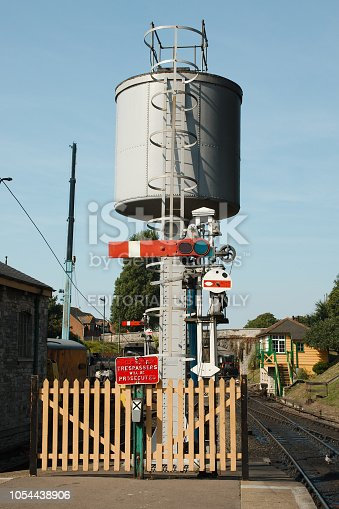 Swanage, Dorset, UK - 3rd September 2018. Vintage water tower and signals still in use on the Swanage steam railway.