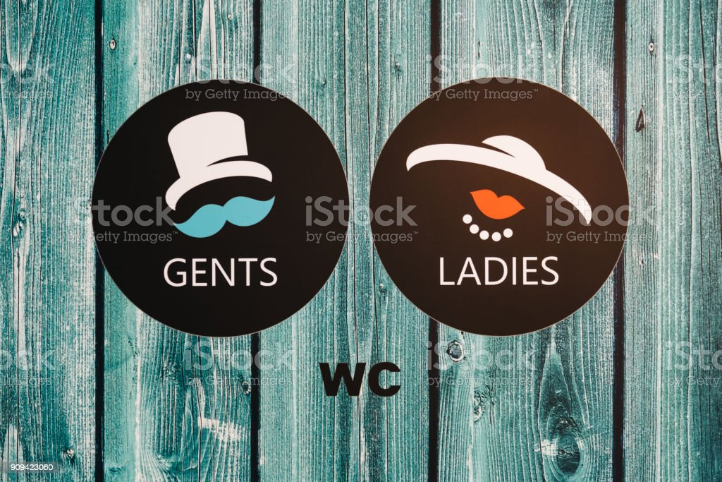Vintage wc signs on wooden green door stock photo
