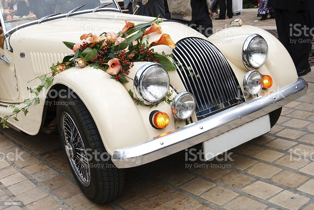 Vintage Wedding Car Decorated with Flowers stock photo
