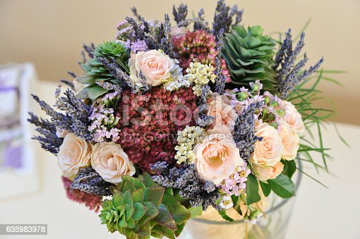 Bouquet of roses , wild flowers and lavender.