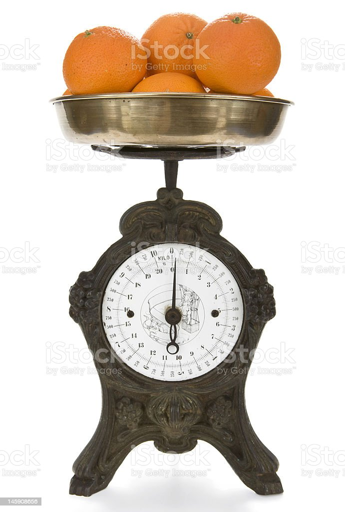 Vintage weight scale with oranges royalty-free stock photo