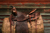 CLose up photo of vintage western leather saddle.