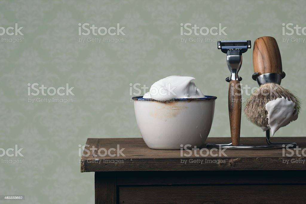 vintage wet Shaving Tools on a wooden Table stock photo