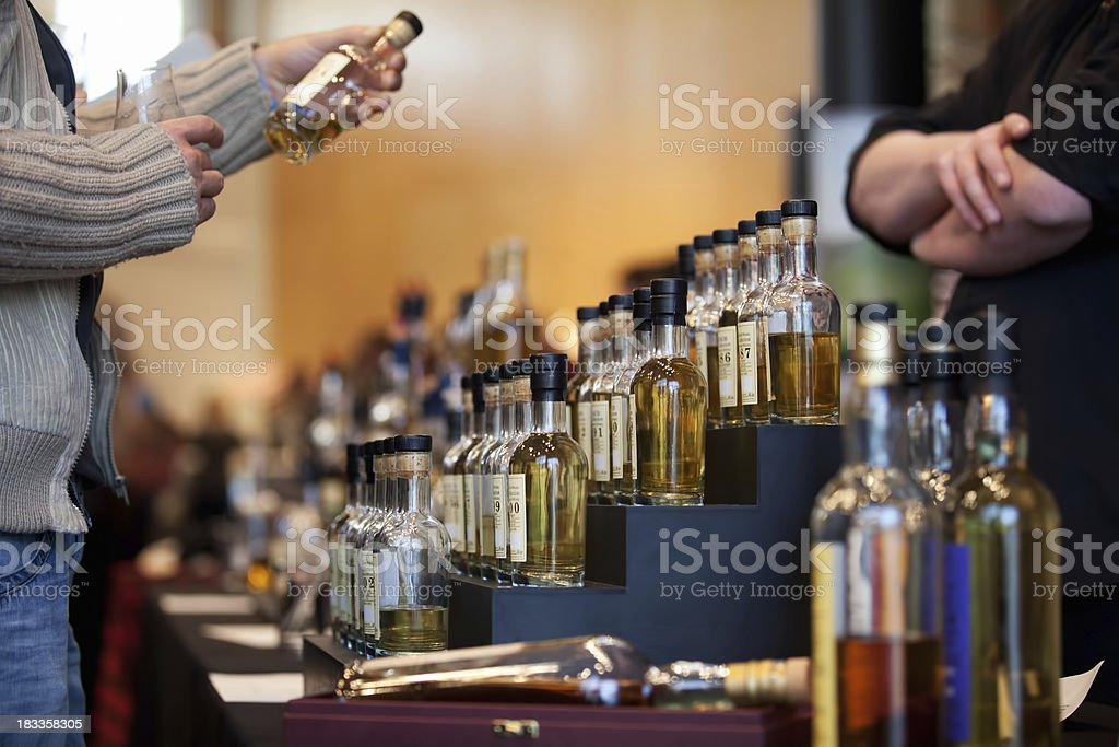 Vintage whiskey bottles being inspected royalty-free stock photo