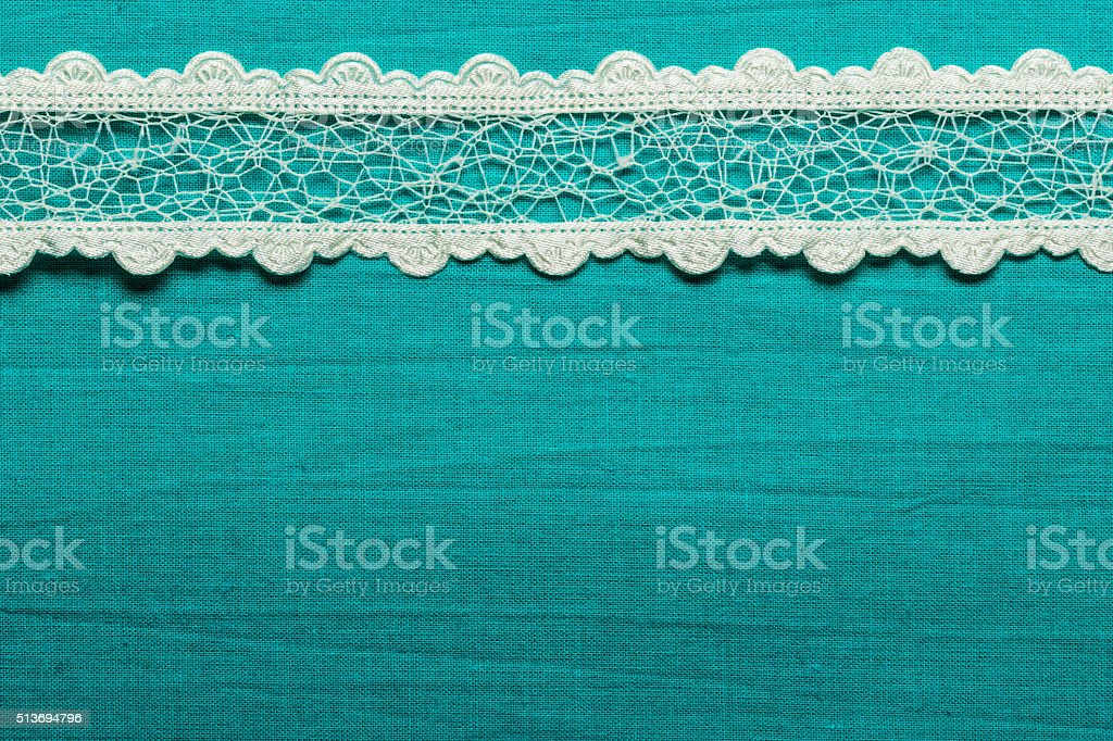 Vintage white lace over blue background stock photo