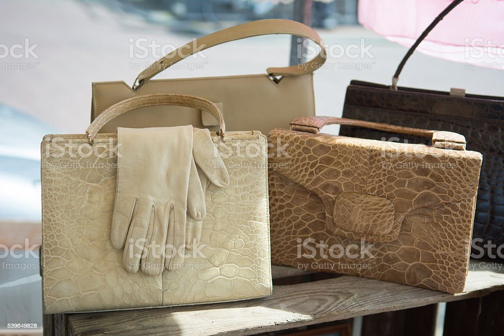 Vintage white leather gloves and handbags on antique market stock photo