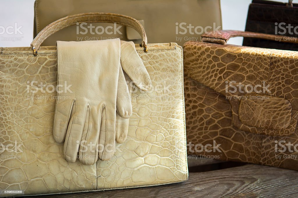 1e967fde7868 Vintage white leather gloves and purse on antique market royalty-free stock  photo