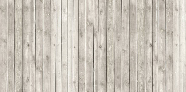 Vintage whitewash painted rustic old wooden  plank wall  textured background. Faded natural wood board panel structure. stock photo