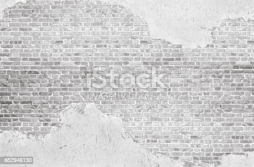 Vintage  whtewashed plastered  old  brick wall  textured background.