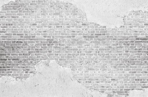Vintage whitewashed plastered  old  brick wall  textured background.
