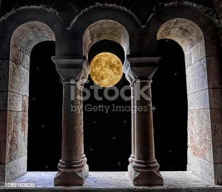 istock Vintage window and colorful night sky 1289163635