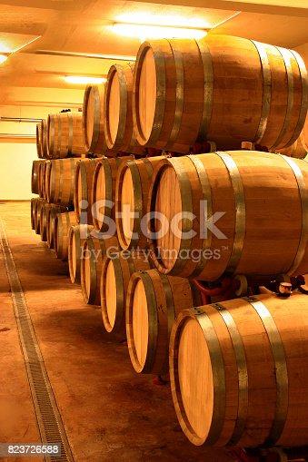 vintage wine cellar full of wine barrels