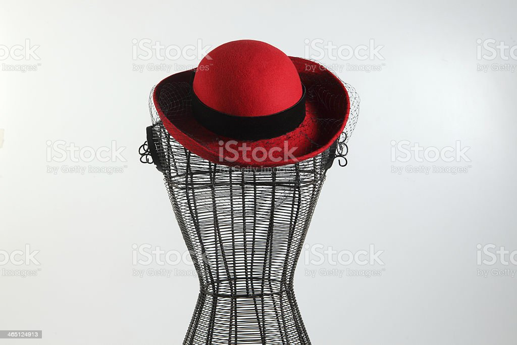 Vintage Wire Dress Form with Red Hat stock photo
