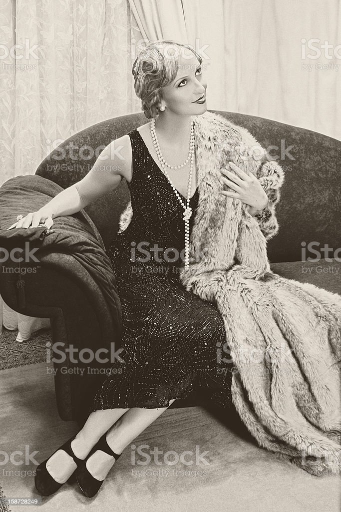 Vintage woman on chaise-longue stock photo