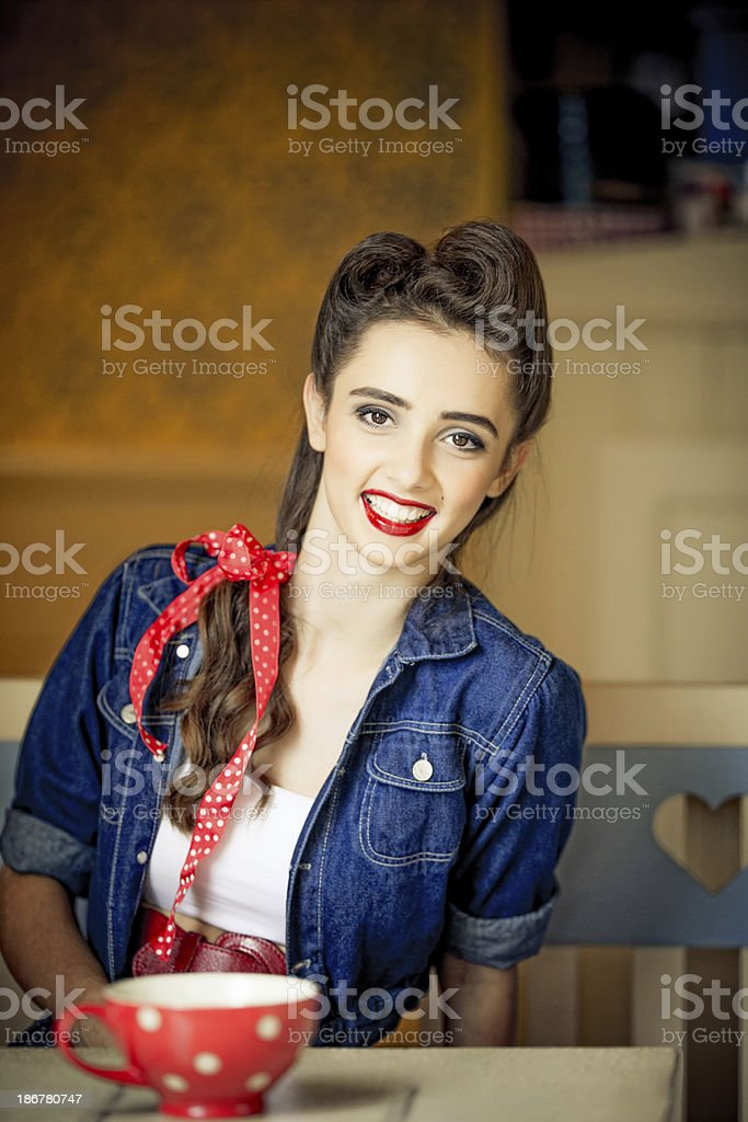 Vintage woman sitting in a coffee shop stock photo