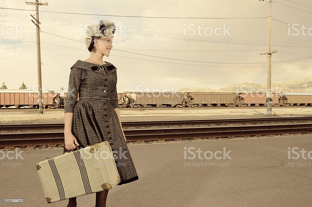 Vintage Woman With Suitcase Waiting For A Train stock photo