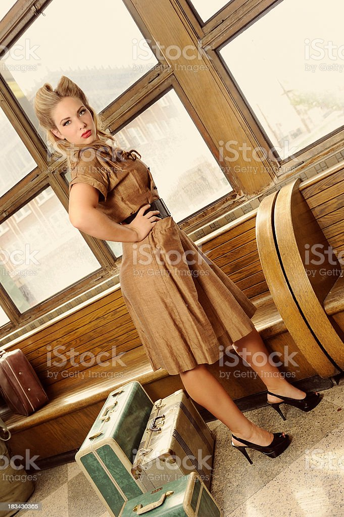 Vintage Woman With Suitcases Waiting At The Bus Station royalty-free stock photo