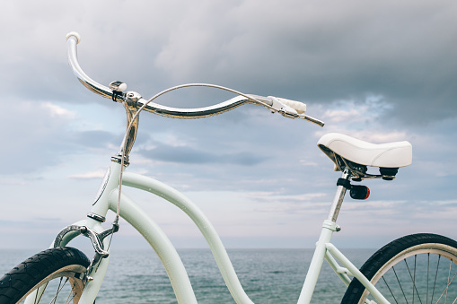 Vintage women's bike on the background of the sea