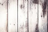 istock Vintage wood background with peeling paint. Vintage beach wood background 1165534735