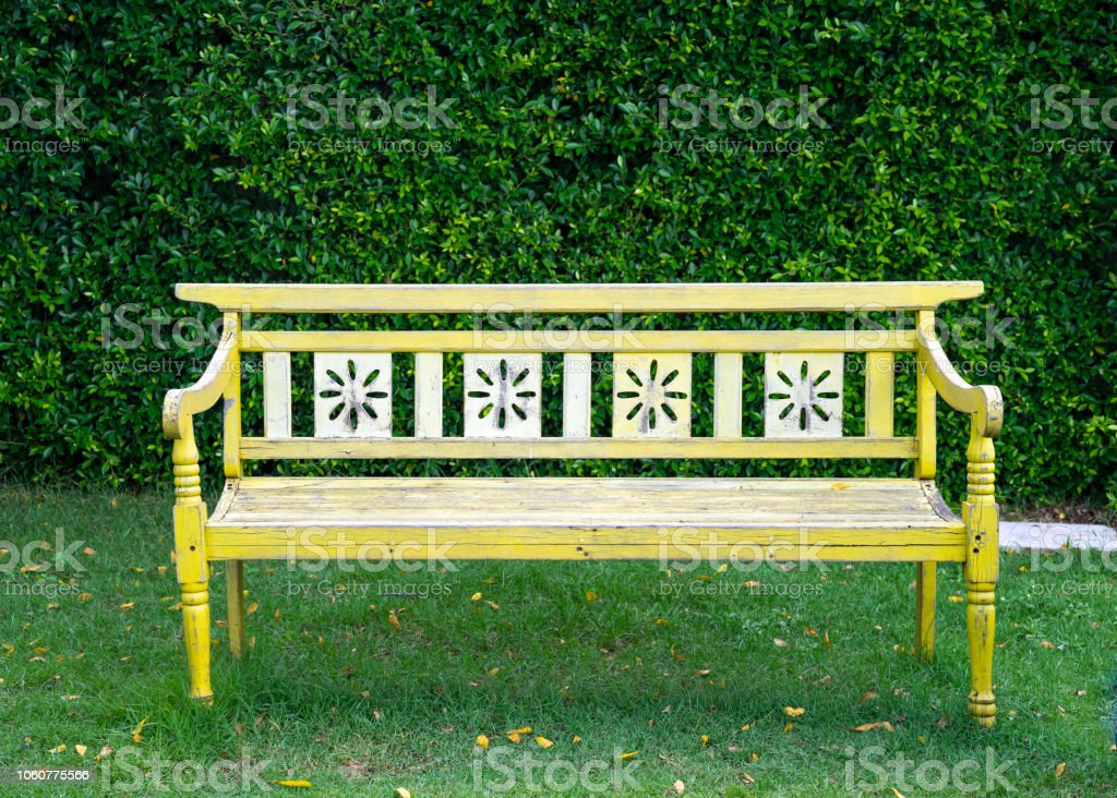 Super Vintage Wood Bench In Garden Against Green Tree Fence Stock Gmtry Best Dining Table And Chair Ideas Images Gmtryco