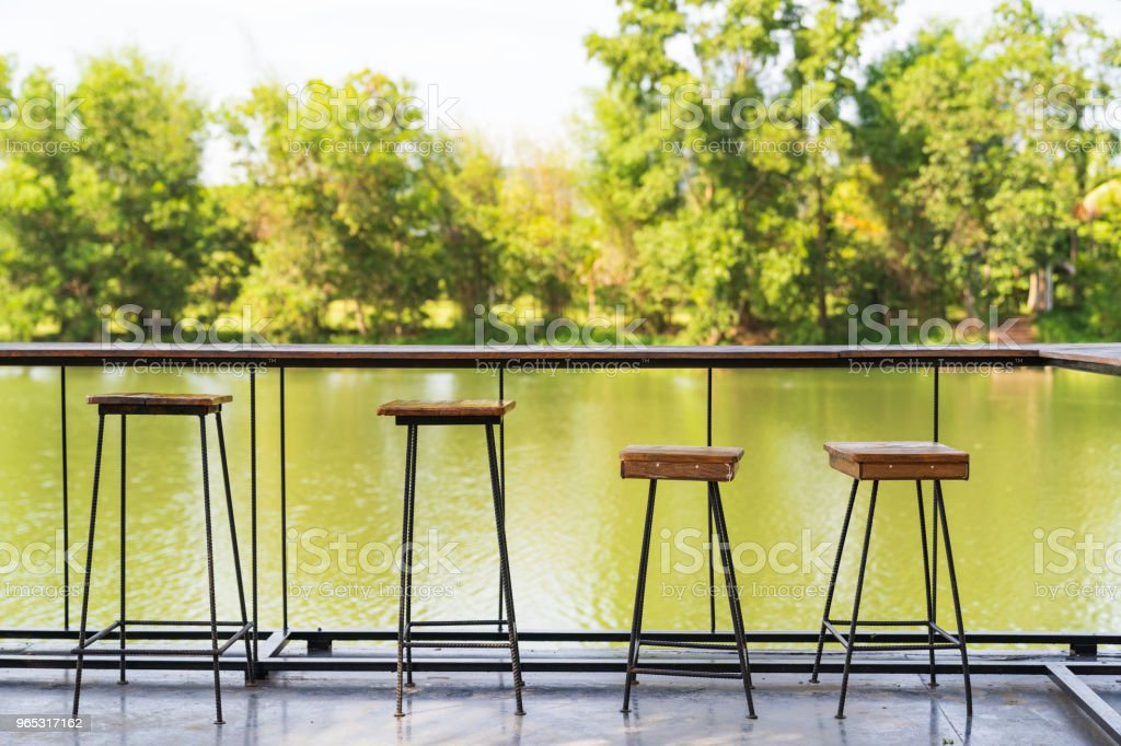 Vintage wood table and chairs on river background. zbiór zdjęć royalty-free