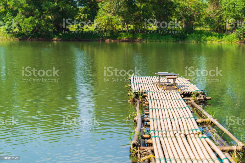 Vintage wood table and chairs on river background. - Zbiór zdjęć royalty-free (Bez ludzi)