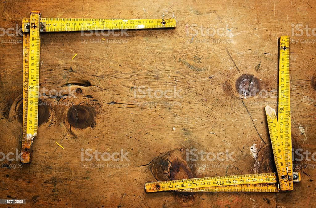 Vintage wood table with two yardsticks stock photo