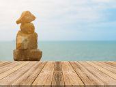 istock Vintage wooden board empty table blue sea background. 494153184
