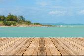 istock Vintage wooden board empty table blue sea background. 494153506