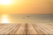 istock Vintage wooden board empty table sea and sky sunset background. 494152230
