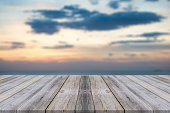 istock Vintage wooden board empty table sea and sky sunset background. 494155106