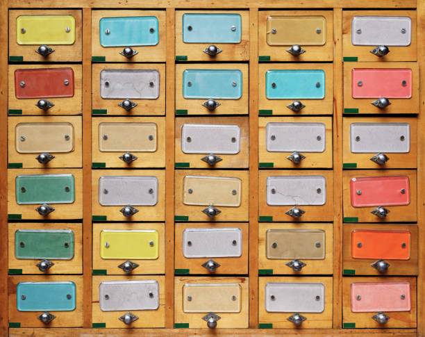 Vintage wooden cabinet with multicolor labels Backgrounds and textures: vintage wooden cabinet with drawers with multicolor labels telephone directory stock pictures, royalty-free photos & images
