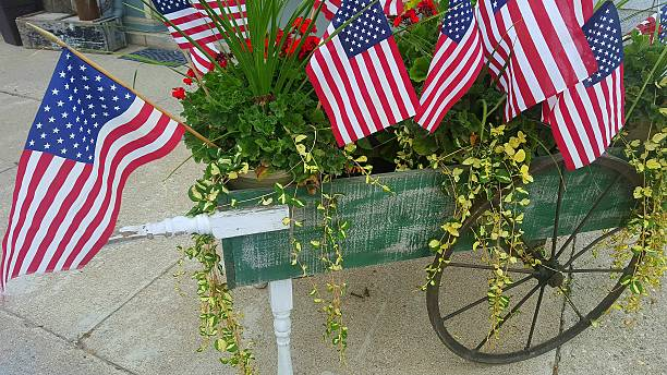 Vintage Wooden Cart Filled with American Flags stock photo
