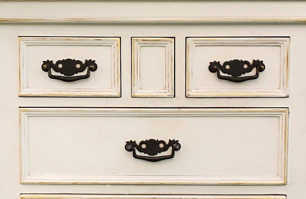 vintage wooden chest of drawers with black metal handles open - schubladenkommode weiß stock-fotos und bilder