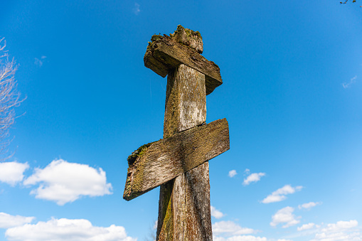 Vintage wooden christian orthodox cross on blue sky background. High quality photo