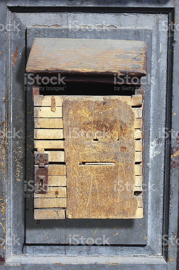 Vintage wooden dropbox hung on a old door royalty-free stock photo