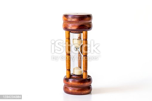 1129545215 istock photo vintage wooden hourglass or sandglass isolated on white background. 1234234384