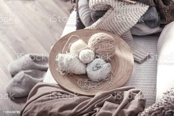 Vintage wooden knitting needles and threads on a cozy sofa with and picture id1133449795?b=1&k=6&m=1133449795&s=612x612&h=jj2qai5 uf fo9wev9ormqonwobfreyfo6atpwsyib0=