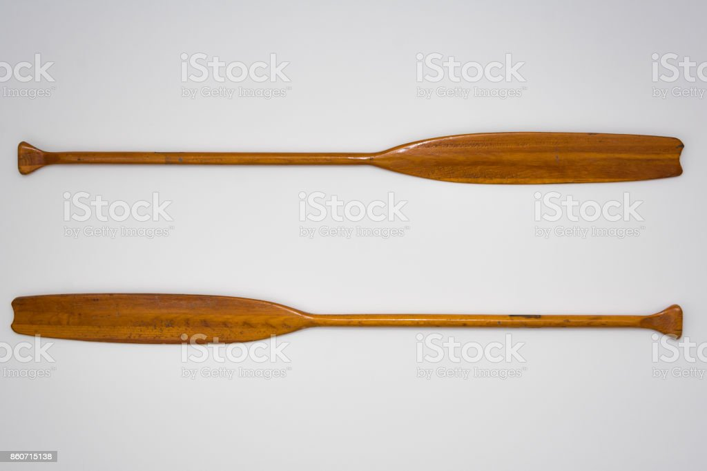 Vintage Wooden Paddle Oars Close Up on White Background stock photo