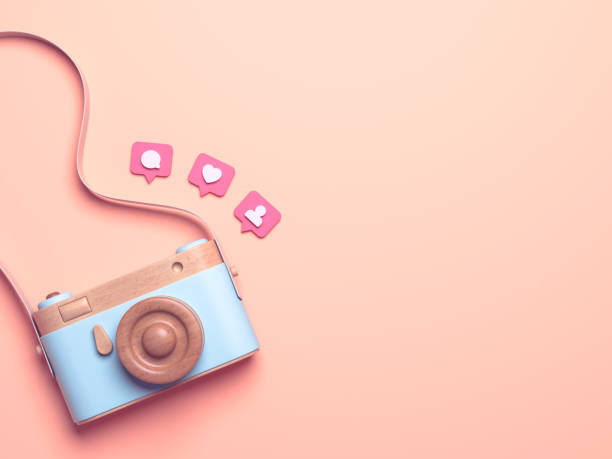 Vintage wooden photo camera with Pin heart, friends, comment, post. Overhead view of Traveler's accessories, Flat lay photography of Travel concept. Pink isolated background. 3d render Vintage wooden photo camera with Pin heart, friends, comment, post. Overhead view of Traveler's accessories, Flat lay photography of Travel concept. Pink isolated background. 3d render auto post production filter stock pictures, royalty-free photos & images
