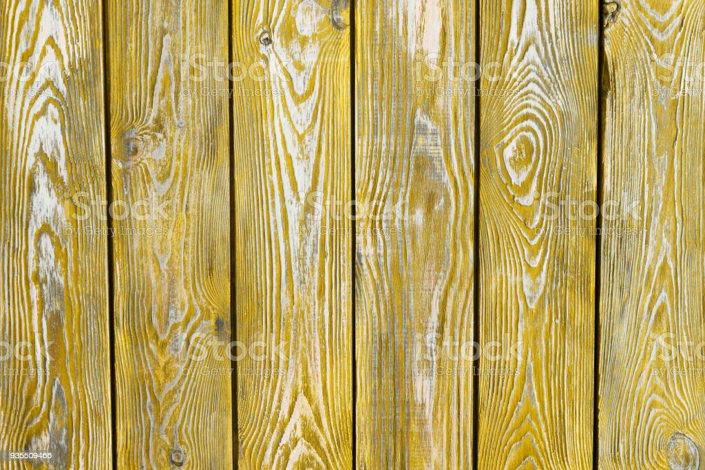 pranchas de madeira vintage pintaram em amarelo - foto de acervo