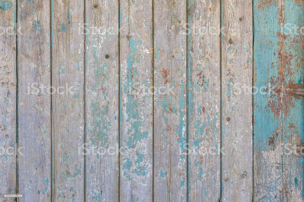 Vintage wooden planks with the remains of the white, red and blue paint as background stock photo