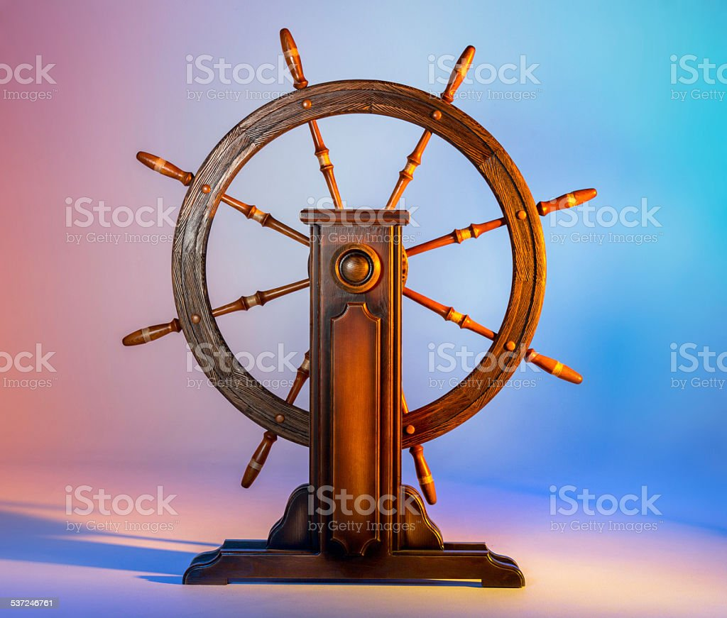 Vintage wooden ship wheel stock photo