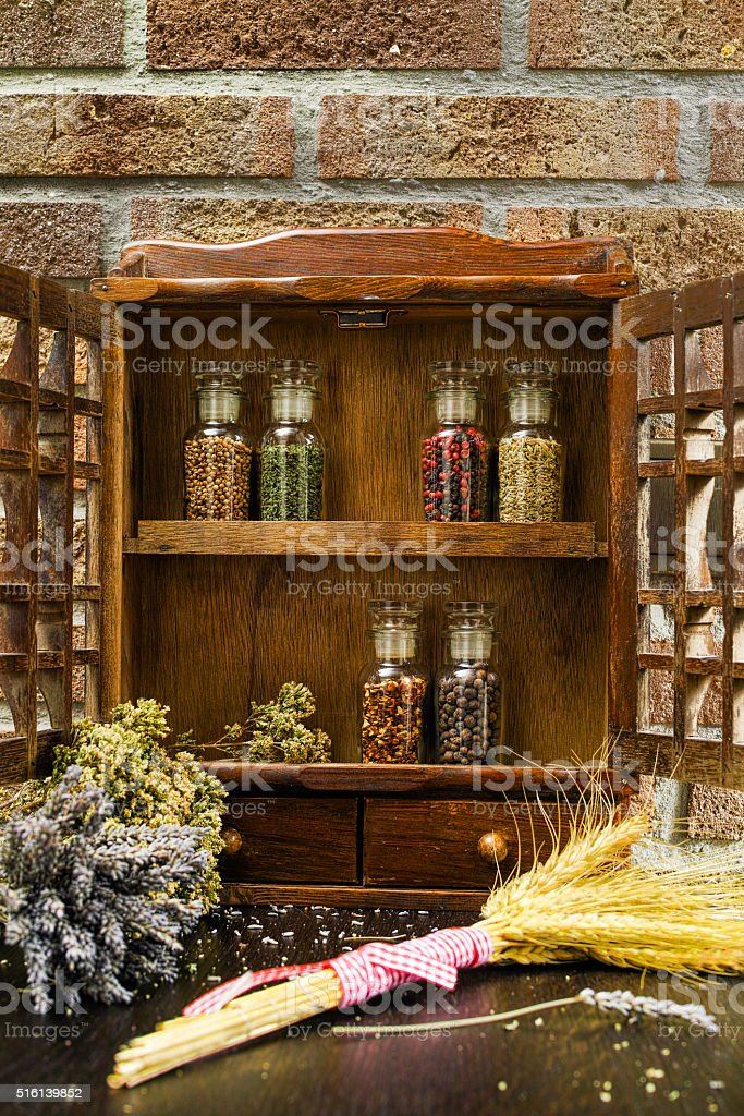 Vintage Wooden Spice Rack Or Storage Cabinet And Six Bottles Stock